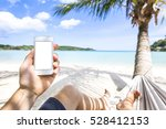 using smartphone on a tropical... | Shutterstock . vector #528412153