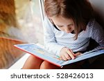 Toddler Girl With Book Near Th...
