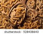 wholemeal fusilli into a spoon. ... | Shutterstock . vector #528438643