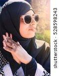 Small photo of Beautiful Arabian Woman wearing hijab, sunglasses and abaya, Fashion Arabic style, Hijab.