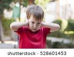little caucasian boy closing... | Shutterstock . vector #528601453