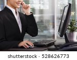 a happy executive wearing suit... | Shutterstock . vector #528626773