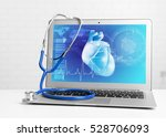 laptop with stethoscope on... | Shutterstock . vector #528706093