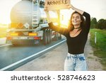 Woman Traveling By Hitchhiking...