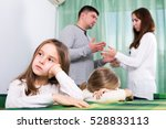 unhappy young family of four... | Shutterstock . vector #528833113