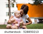 small cute baby and nice mom... | Shutterstock . vector #528850213