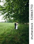 the bride and groom in the park.... | Shutterstock . vector #528865753