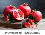 ripe pomegranate with leaves on ... | Shutterstock . vector #528908887