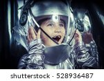 boy playing to be an astronaut... | Shutterstock . vector #528936487
