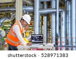 engineer using laptop computer... | Shutterstock . vector #528971383