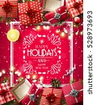 gift boxes and baubles on red... | Shutterstock .eps vector #528973693
