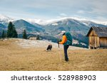 hiker with a backpack admires... | Shutterstock . vector #528988903