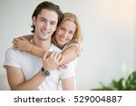 young happy woman piggybacking... | Shutterstock . vector #529004887