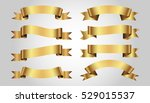 set of golden ribbons on gray... | Shutterstock .eps vector #529015537