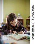 Small photo of Girl doing homework