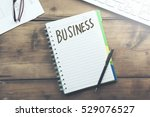business word on notepad and ...   Shutterstock . vector #529076527
