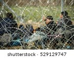 refugees waiting behind barbed... | Shutterstock . vector #529129747