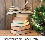old books and christmas tree on ... | Shutterstock . vector #529129873