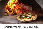 colorful kale pizza being... | Shutterstock . vector #529161583