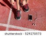 runner woman athlete tying... | Shutterstock . vector #529270573
