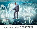 businessman doing tightrope... | Shutterstock . vector #529337797