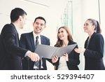 asian business team discussing... | Shutterstock . vector #529394407