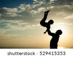 father and son playing on the... | Shutterstock . vector #529415353