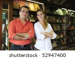 proud family business partners owners of a small bookstore - stock photo