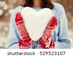 Young Woman Holding Snow Heart