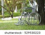 empty wheelchair parked in park | Shutterstock . vector #529530223