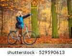 active woman riding bike... | Shutterstock . vector #529590613