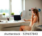 young businesswoman sitting at... | Shutterstock . vector #529657843