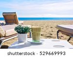 latte at the beach. iced coffee ... | Shutterstock . vector #529669993