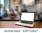 laptop with blank screen on... | Shutterstock . vector #529711627
