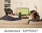 kids watching tv at home | Shutterstock . vector #529792417