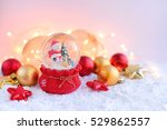 a snow globe with snowman with... | Shutterstock . vector #529862557