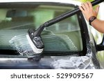 using a brush to wash a car on... | Shutterstock . vector #529909567