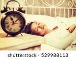 young woman sleeping in bed... | Shutterstock . vector #529988113