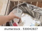 woman's hand throwing scarp of... | Shutterstock . vector #530042827