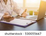 Doctor working a  health check , Healthcare and medical concept,Stethoscope with clipboard and Laptop on desk.writing prescription recording test results in background,vintage color,selective focus