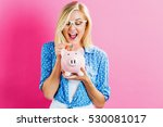 young woman with a piggy bank... | Shutterstock . vector #530081017