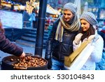 young couple buying roasted... | Shutterstock . vector #530104843