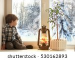 Little Boy Sitting On A White...