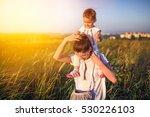 family portrait of happy mother ... | Shutterstock . vector #530226103