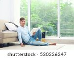 young handsome man reading book ...   Shutterstock . vector #530226247