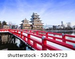 Small photo of old castle in japan. Matsumoto castle against blue sky in Nagono city, Japan.Castle in Winter with heavy snowfall.Travel Matsumoto Castle with frozen pond in Winter.a Japanese premier historic castles