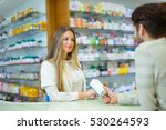 attractive smiling pharmacist... | Shutterstock . vector #530264593