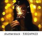 woman holding sparkler against...   Shutterstock . vector #530269423