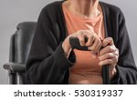 old woman sitting and holding... | Shutterstock . vector #530319337
