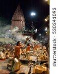 Small photo of Varanasi / India 22 June 2015 An unidentified Hindu priest performs religious Ganga Aarti ritual at Dashashwamedh Ghat in Varanasi uttar pradesh India